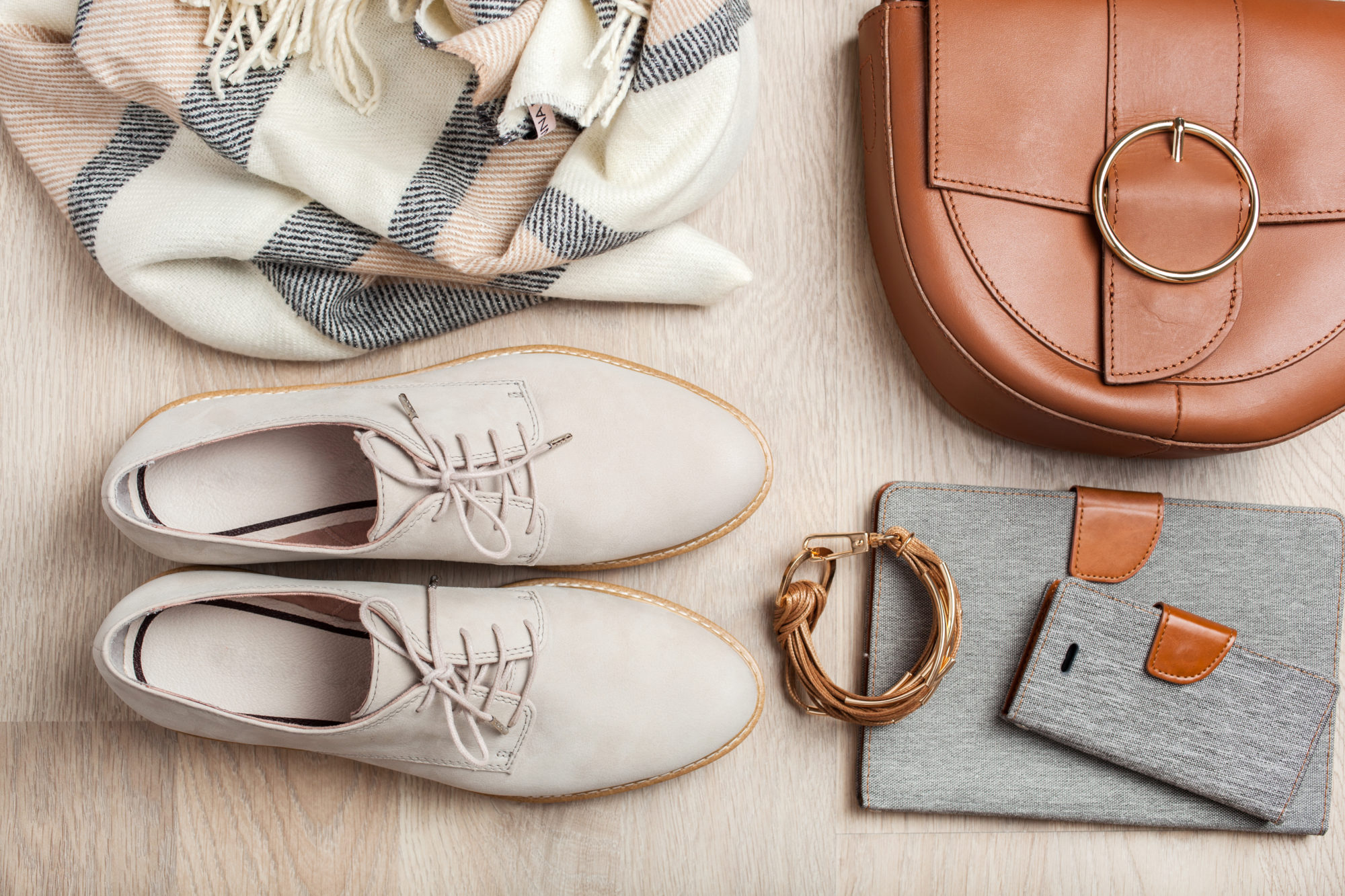 women's flat lay clothes shoes, scarf, bracelet, bag, tablet, smartlphone. Fashion blog, clothing, shopping